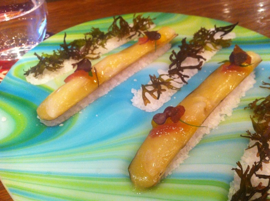 Razor clams with escabeche sauce, saffron pearls and soy sauce shards