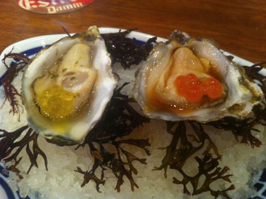 The Oysters #5: one with sherry vinegar, tarragon and olive oil caviar, and the other with oriental vinagrette and salmon roe